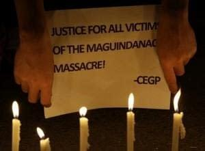 Student protesters hold a slogan denouncing the killing of 58 people, including at least 32 media workers, during a rally in suburban Quezon City, north of Manila, Philippines on Sunday Nov. 21, 2010. Almost a year has past since Andal Ampatuan Jr., the scion of a powerful clan, was said to have led his men in killing 58 people, including 32 media workers, in southern Maguindanao province.(AP Photo/Aaron Favila)