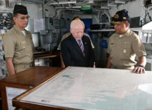 Aboard PF-16. Capt. Ernesto Baldovino, commanding officer of the BRP Ramon Alcaraz (PF-16) shows Ambassador Jose L. Cuisia Jr. the route the vessel will take on its way home to the Philippines. Looking on is Capt. Elson Aguilar, Defense and Naval Attache at the Philippine Embassy in Washington, D.C. (Philippine Embassy Photo by Elmer G. Cato)