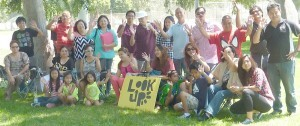 """LOOK UP! MOVEMENT AT LA VETERANS PARK:  Pastor Fergel Cruz, extreme right, and his family in collaboration with Pastor Benjie Beatima of Temecula, take advantage of California's beautiful parks as they bring the Gospel to the people through the """"Look Up! Movement"""" launched in July at the Echo Park in LA. The group will attempt to cover 50 parks until 2014 as part of its evangelical mission."""