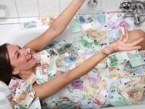 """Really?: An alleged photo of Jeane Napoles, daughter of Janet Lim-Napoles who is at the center of the pork barrel scam that involves lawmakers in the Philippines, as she is supposedly """"bathing"""" in a tubful of money that has been circulating on the internet. This one was posted in en.wordpress.com."""