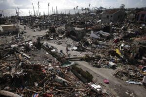 Residents walk in a village among houses destroyed by super Typhoon Haiyan in Tanauan, Leyte in central Philippines November 14, 2013. (MNS photo)