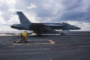PHILIPPINE SEA (Dec. 1, 2013) Lt. Caleb McDonald, a shooter assigned to the aircraft carrier USS George Washington (CVN 73), launches an F/A-18E Super Hornet from the Eagles of Strike Fighter Squadron (VFA) 115 during the Carrier Air Wing (CVW) 5 fly-off. George Washington and its embarked air wing, CVW 5, provide a combat-ready force that protects and defends the collective maritime interest of the U.S. and its allies and partners in the Indo-Asia-Pacific region. (U.S. Navy photo by Mass Communication Specialist 3rd Class Ricardo R. Guzman/Released)