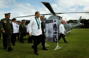 """President Benigno S. Aquino III inspects the three newly acquired Agusta helicopters during the 78th Founding Anniversary of the Armed Forces of the Philippines (AFP) at the AFP General Headquarters Grandstand in Camp General Emilio Aguinaldo, Quezon City on Friday (December 20, 2013). This year's theme is: """"Tagumpay Noon, Bayanihan Ngayon, Karangalan Nating Lahat Bukas"""". In photo are Defense Secretary Voltaire Gazmin and AFP Chief of Staff General Emmanuel Bautista. (Photo by: Gil Nartea / Malacañang Photo Bureau)"""