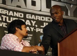 """Undefeated junior welterweight champion Manny """"Pacman"""" Pacquiao of the Philippines (L) greets Timothy """"Desert Storm"""" Bradley Jr. of the U.S. during a news conference in New York February 23, 2012. Pacquiao will fight Bradley for the world championship on June 9, 2012 in Las Vegas, Nevada.  REUTERS/Brendan McDermid (UNITED STATES - Tags: SPORT BOXING)"""