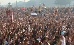 """Tens of thousands of Catholic devotees raise their hands as they chant """"Viva Nazareno"""" during the annual religious procession of the statue of the Black Nazarene in Manila January 9, 2012. President Benigno Aquino warned on Sunday that officials were bracing for a possible Islamist militant attack in the capital on the eve of a religious procession to be joined by millions of barefoot devotees. The Black Nazarene, a life-size wooden statue of Jesus Christ carved in Mexico and brought to the Philippines in the 17th century, is removed from the Quiapo church on January 9 each year. Believed to have healing powers in the predominantly Roman Catholic country, it is paraded through the narrow streets of Manila's old city from dawn to midnight."""