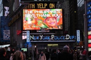 """Electronic billboards lit up with """"Thank you"""" signs at New York's Times Square (shown above), Galeries Lafayette in Paris, Tokyo's Shibuya Crossing, London's Piccadilly Circus and five other cities at 2040 GMT Friday, exactly three months after Super Typhoon Haiyan struck the central Philippines."""