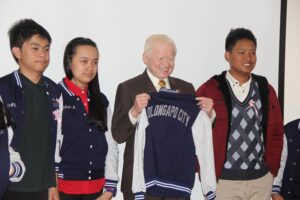 """Pinoy Pride. The Filipino students representing the country gifts Ambassador Jose L. Cuisia, Jr. with a jacket that proudly says """"Olongapo City."""" (Philippine Embassy Photo by Majalya Fernando)"""