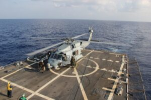 GULF OF THAILAND (March 9, 2014) A U.S. Navy MH-60R Sea Hawk helicopter from Helicopter Maritime Strike Squadron (HSM) 78, Det 2, assigned to the guided-missile Destroyer USS Pinckney (DDG 91), lands aboard Pinckney during a crew swap before returning on task in the search and rescue for the missing Malaysian airlines flight MH370. The flight had 227 passengers from 14 nations, mainly China, and 12 crew members. According to the Malaysia Airlines website, three Americans, including one infant, were also aboard. (U.S. Navy photo by Senior Chief Petty Officer Chris D. Boardman/Released)
