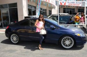 Kristine Castillo, after receiving the keys from Merlinda Dichoso of Victory Autos, proudly displays her newly-purchased 2010 2-door Honda Civic she recently got from Victory Autos. If you don't have perfect credit, Victory Autos  can help you. All you need is a paystub.