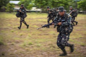 Philippine Army Cpl. Kenneth Dumagco, foreground, moves to a notional extract location during helicopter insert and extract training with U.S. soldiers on Fort Magsaysay, Philippines, April 29, 2014. U.S. Marine Corps photo by Staff Sgt. Pete Thibodeau