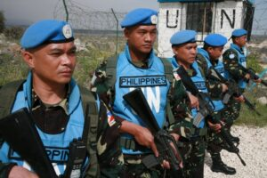 """More than 40 peacekeepers from Fiji were forced to surrender their weapons and were taken hostage in Golan Heights, but 81 Filipino blue helmets (shown above) """"held their ground"""" and refused to disarm, reports from Manila said. Photo: Elmer G. Cato, DFA Consul/Golan Heights."""