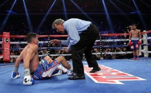 Referee  Genaro Rodriguez counts as Chris Algieri tries to pull himself up after being knocked down by Manny Pacquiao during their welterweight title fight in Macao on Sunday.(MNS photo)