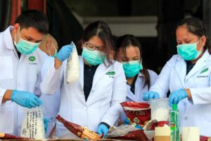 """Philippine Drug Enforcement Agency (PDEA) chemists test samples of illegal methamphetamine hydrochloride, known locally as """"shabu,"""" before disposing it at a waste management center in Cavite province on Tuesday. The estimated 5.78 kilograms of assorted illegal drugs and paraphernalia amounting to P2.25 billion were confiscated in Subic, Zambales, and Batangas.  (MNS photo)"""