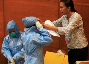 Health workers practice wearing protective suits and equipment during the 'One Nation, One Direction for EBOLA Prevention' training at the Research Institute for Tropical Medicine (RITM) hospital in Muntinlupa City on Tuesday, October 28. A first batch of personnel from government hospitals from all over the country is undergoing specialized training on Ebola measures from six international experts. DOH spokesman Dr. Lyndon Lee Suy said the procedures in the training modules will cover, among others, the patient's entry into triage, confinement, and in case of 'non-event,' how their case may be used in ruling future cases. (MNS photo)