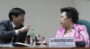 Senator Bongbong Marcos speaks with Senator Miriam Defensor Santiago during the hearing on the Bangsamoro Basic Law, Monday morning.  (MNS photo)
