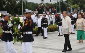 """President Benigno S. Aquino III offers a wreath during the commemoration of the 118th anniversary of the martyrdom of Dr. Jose Rizal at the Rizal National Monument in Rizal Park, Manila City on Tuesday (December 30), with the theme: """"Rizal 2014: Dunong at Pusong Pilipino."""" Also in photo is National Historical Commission of the Philippines chairperson Dr. Maria Serena Diokno. (MNS photo)"""
