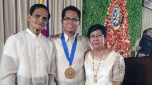 Presidential Award winner Roderick Dela Cruz, pictured here with his parents, is a senior engineer with Southern California Edison.