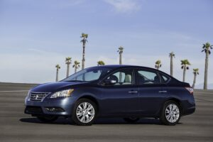 """2015 Nissan Sentra: Nissan Sentra's exterior design is elegant, modern and refined, reflecting a """"professional"""" character targeted at upwardly bound buyers who aspire to drive something more premium than some of the other designs in the segment. It adopts Nissan's bold signature trapezoid-shaped grille and large wraparound headlights with standard LED accents. In the rear, LED taillights are also standard, which complement the sophisticated styling."""