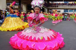 Young girls in floral costumes dance at the opening parade of the month-long Panagbenga Festival celebration Sunday. Students from 12 elementary schools in Benguet competed during the elimination round for a chance to participate in the main Street Dancing Competition on February 28. (MNS photo)