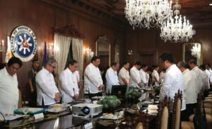 """President Benigno S. Aquino III leads his official family in prayer before presiding over the National Economic and Development Authority (NEDA) Board Meeting at the Aguinaldo State Dining Room of the Malacañan Palace on Monday (February 16, 2015). Also in photo are Presidential Communications Operations Office Secretary Herminio """"Sonny"""" Coloma, Jr., Science and Technology Secretary Mario Montejo, Tourism Secretary Ramon Jimenez, Jr., Secretary to the Cabinet Jose Rene Almendras, Finance Secretary Cesar Purisima, Environment and Natural Resources Secretary Ramon Jesus Paje, Energy Secretary Carlos Jericho Petilla, Presidential Management Staff Head Julia Andrea Abad and Transportation and Communications Secretary Joseph Emilio Aguinaldo Abaya. (MNS Photo)"""