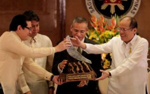 """President Benigno S. Aquino III to present the TAYO award during the Ten Accomplished Youth Organizations Year 12 (TAYO 12) Awarding Ceremonies at the Heroes Hall of the Malacañan Palace on Tuesday (February 24). Since 2002, TAYO Awards recognizes and supports the outstanding contributions of youth organizations to the country. Also in photo are TAYO Awards founding president and Senator Paolo Benigno """"Bam"""" Aquino IV, Presidential Assistant for Food Security and Agricultural Modernization Francis Pangilinan and Coca-Cola Foundation Philippines vice chairman Juan Ramon Felix. (MNS photo)"""