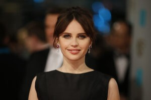 British actress Felicity Jones poses on the red carpet for the BAFTA British Academy Film Awards at the Royal Opera House in London on February 8, 2015. ©AFP PHOTO / JUSTIN TALLIS