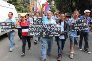 Members of the militant drivers and operators of public utility jeep (PISTON) Tuesday marched to Supreme Court to urged justices to decission their petition to stop (TRO)  for the implememtation of high traffic fines under the JAO no. 2014-01. Photo by: R.M.