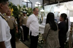 President Benigno S. Aquino III personally extends his condolences to the family of slain Marine Corporal Josen Mias and Sergeant Francis Jeffel Flores during the wake at the Fort Bonifacio Naval Station Mortuary in Taguig City on Monday afternoon (March 16). President Aquino recognized the heroism of the two marines killed in encounters with Bangsamoro Islamic Freedom Fighters (BIFF) in Maguindanao. (MNS photo)