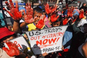 Members of Bayan Southern Tagalog hold a protest outside the US Embassy in Manila, Thursday, condemning the alleged participation of the United States in the Mamasapano operation last January 25. The group also called for President Aquino's resignation over his accountability for the death of 44 PNP SAF troopers. (MNS photo)