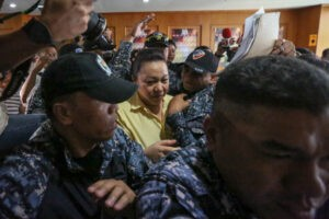 Janet Lim Napoles (center), the alleged pork barrel scam queen, is escorted out of the court room after being found guilty on her kidnapping and serious illegal detention case of scam whistleblower Benhur Luy at the Makati Regional Trial Court on Tuesday. Napoles was sentenced to permanent imprisonment.  (MNS photo)