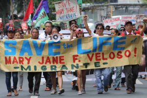 Supporters rally outside the Indonesian Embassy in Makati City on Friday appealing for clemency for Filipino Mary Jane Veloso, convicted of drug trafficking in Indonesia. Veloso has been moved to an island prison and is awaiting final word on her execution from Indonesian authorities. (MNS Photo)