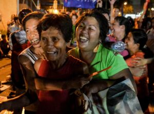 Activists react after it was announced that the execution was delayed for death row prisoner Mary Jane Veloso, during a vigil outside Indonesian embassy in Makati, Philippines April 29, 2015. The execution of a Filipina drug convict by an Indonesian firing squad was delayed at the last minute after one of her recruiters surrendered to police in the Philippines, the attorney general's spokesman said on Wednesday.(MNS photo)