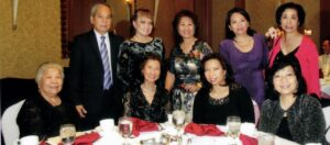 Lydia V. Solis, newly-inducted president of the Philippine Women's University Alumni Association of Southern California celebrates with family, friends and media colleague on March 14, in Cerritos, Calif. Seated from left: Lilia A. Solis, Lulu S. Alcayde, and Aquino sisters Medy and Miriam. Back row: Carlos Antonio Jr. and Vilma Elder, Lydia, Jovy Aquino and Myrna Aquitania. Photo by Ted Talag.