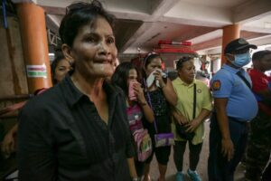 Relatives of victims of a fire that gutted a footwear factory in Valenzuela City arrive at the town hall of Barangay Ugong in Valenzuela City on Thursday to identify the remains of their loved ones. 72 people died in the fire, most of whom workers who were trapped inside the burning factory.(MNS Photo)