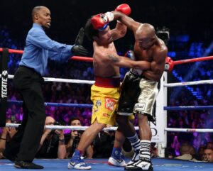 """Manny """"Pacman"""" Pacquiao, seen here slugging with Floyd Mayweather in his lost fight Saturday, expressed his disappointment at the Nevada State Athletic Commission (NSAC) after he was denied an injection inside the locker room that could have numbed the pain in his injured right shoulder. Photo: Chris Farina / Top Rank"""