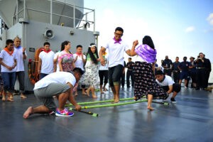 SOUTH CHINA SEA (May 10, 2015) Culinary Specialist 2nd Class Johnmatthew Relova and Culinary Specialist Seaman Agnelia Morena perform the traditional Filipino dance, Tinikling, during an Asian-Pacific Islander Heritage Celebration on the ship's main deck. Blue Ridge is conducting patrols, strengthening and fostering relationships within the Indo-Asia Pacific region. (U.S. Navy photo by Mass Communication Specialist 2nd Class Phillip Pavlovich/Released)