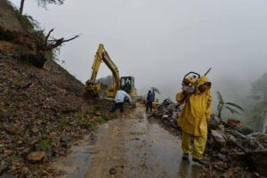 Department of Public Works and Highways personnel rush to clear a portion of Kennon Road that was blocked by a landslide at the height of tropical storm Egay's onslaught Monday in Benguet province. Storm signals were raised in several provinces as Egay barreled accross Luzon. (MNS photo)