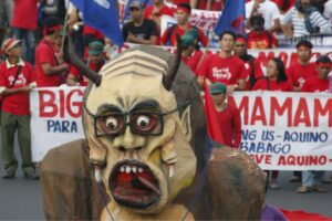 Protesters march with an effigy of President Benigno Aquino towards Batasang Pambansa in Quezon city on Monday, July 27. Aquino will address the joint session of Congress, delivering his last State of the Nation speech this afternoon. (MNS photo)