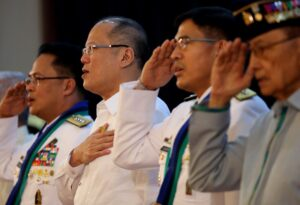 President Benigno S. Aquino III, accompanied by outgoing AFP Chief General Gregorio Pio Catapang, Jr., and newly appointed AFP Chief of Staff Lt. Gen. Hernando Iriberri review the Honor Guards during the Testimonial Honors and Armed Forces of the Philippines (AFP) Change of Command Ceremony at the Tejeros Hall of the AFP Commissioned Officer's Club (AFPCOC), Camp General Emilio Aguinaldo in Quezon City on Friday (July 10, 2015). (MNS photo)