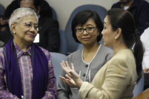 Senator Loren Legarda (right), chairperson of the Senate Committee on Finance, talks with Office of the Presidential Adviser on Peace Process (OPAPP) Secretary Teresita Quintos Deles (left) and Professor Miriam Coronel-Ferrer before the start of the Senate Session on Wednesday (Aug. 12, 2015). (MNS photo)
