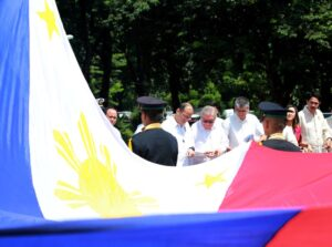"""President Benigno S. Aquino III leads the commemoration of the 137th Birth Anniversary of President Manuel L. Quezon (PMLQ) and the Inauguration of the """"Museo ni Manuel L Quezon"""" during the flag raising ceremony at the Quezon Memorial Shrine in Elliptical Road, Quezon City on Wednesday (August 19, 2015). Also in photo are House Speaker Feliciano Belmonte, Jr.; Executive Secretary Paquito Ochoa, Jr.; and Quezon City Vice Mayor Ma. Josefina Belmonte. (Photo by Rey Baniquet / Malacañang Photo Bureau / PCOOMNS Photo)"""