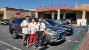 Ed and Connie Ang with their newly-purchased 2016 Mitsubishi Outlander SE Quartz Brown from the  Puente Hills Mitsubishi Filipino Sales Alex Jacinto.