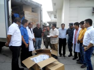 """Medical supplies were officially turned over by George Kenneth Lee [LDS Charities Project Manager] and US Navy SCPO Guy Gagui and S7 Luis Siguenza together with Angeles Philippines Stake President,Jose M. Briones at Ospital Ning Angeles to Dr.Antonio G. Dizon (Chief of Hospital) with the presence of Honorable Mayor Ed Pamintuan and other local government officials.  (from left) Alex Cauguiran [mayor's chief of staff], George Kenneth  Lee [ Latter-Day Saints Charities Welfare manager], Dr. Antonio Dizon [hospital director of ONA], Councilor Carmelo """"Pogi"""" Lazatin, US Navy SCPO Guy Gagui, Angeles City Honorable Mayor Edgardo Pamintuan , Jose M. Briones [Angeles Philippines Stake President of The Church of Jesus Christ of Latter Day Saints], S7 Luis Siguenza , Dr. Rodel Dungca [Deputy Chief of the Hospital], Councilor Alex Indiongco and Councilor Edu Pamintuan (photo by P.Lagman)"""