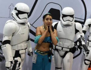 A fan in costume poses with Stormtroopers at a Star Wars display during the Disney D23 EXPO 2015 held at the Anaheim Convention Center in Anaheim, California on August 14, 2015 (AFP Photo/Mark Ralston)