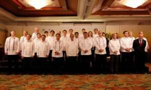 President Benigno S. Aquino III, together with Finance Secretary Cesar Purisima, share the stage with the heads of finance ministries across Asia-Pacific and top executives of multinational financial institutions who attended the APEC Finance Ministers Meeting held at Shangri-La Mactan in Lapu-Lapu City in Cebu province on Thursday (September 10).  (MNS photo)