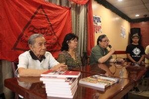 Veteran Franco Arcebal and Bernie Ganon listen as Justice for Filipino American Veterans Coordinator Art Garcia stresses a point. Photo: Odette Galino