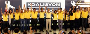 """Liberal Party (LP) chairman President Benigno S. Aquino III raises the hands of the administration senate slate for the 2016 national elections during the Koalisyon ng Daang Matuwid: Ang Pagpapakilala at the Balay Expo Centro Building in EDSA corner McArthur Avenue, Araneta Center, Cubao, Quezon City on Monday (October 12). The 12 senatorial bets includes COOP NATCCO party-list Representative Cresente Paez; Philippine Health Insurance Corporation (PhilHealth) director and former Akbayan party-list Representative Ana Theresia """"Risa"""" Hontiveros-Baraquel; former Technical Education and Skills Development Authority (TESDA) Director General Emmanuel """"Joel"""" Villanueva; former Energy Secretary Jericho Petilla; Senator Ralph Recto; Senate President Franklin Drilon; former Senator and former food security czar Francis """"Kiko"""" Pangilinan; former Justice Secretary Leila de Lima; Interior and Local Government Assistant Secretary for Muslim Affairs and Special Concerns Nariman Ambolodto; Senator Teofisto """"TG"""" Guingona III; and Tourism Infrastructure and Enterprise Zone Authority (TIEZA) general manger and chief operating officer Mark Lapid. Also in photo are LP Presidential Candidate former DILG Secretary Manuel Roxas II; LP Vice Presidential Candidate Camarines Sur 3rd District Representative Maria Leonor """"Leni"""" Robredo; and LP vice chairman and House Speaker Feliciano Belmonte, Jr. (MNS photo)"""
