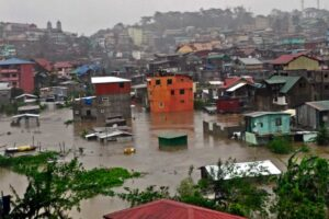 Several houses are submerged at the City Camp Lagoon in Baguio City on Monday after intense rains spawned by Typhoon Lando. More than 200 families were evacuated from the area, a perennial catch-basin for floodwaters in the summer capital during torrential rains. (MNS Photo)