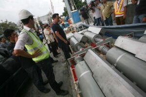 MMDA Chairman Francis Tolentino and Freyssinet project manager Alexandre Gros on Monday inspect the seismic damper that will be attached beneath the Ayala Bridge to help strengthen its foundation. MMDA advised motorists to take alternative routes, as the bridge will remain closed until October 1.(MNS photo)