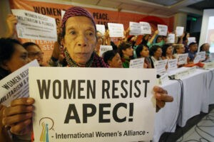 """Women activists hold a protest against the Asia Pacific Economic Cooperation (APEC) during a meeting in Quezon City on Wednesday. The group slammed what it called as a """"grand conspiracy to push the military and political agenda of imperialist domination"""" over women and poor people in the region.(MNS photo)"""